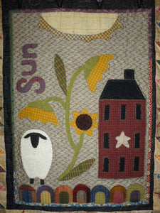 Wool applique on fabric wall hanging quilt pattern