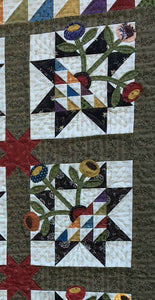 scrappy wall hanging quilt pattern with fabric applique