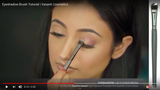 A girl applying eyeshadow on her eyes using Vasanti Eyeshadow - Lay it down brush - Screenshot from Youtube video