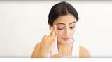 A woman trying out and wiping her makeup using Vasanti Makeup Magnet Wipes