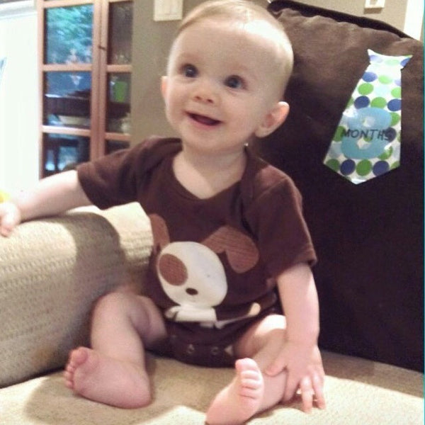 Baby boy wearing Dog baby onesie by Baby Lux Design