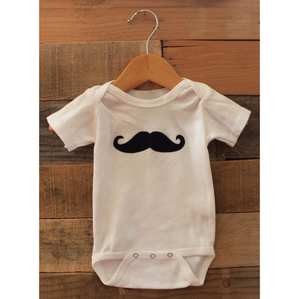 Baby onesie with mustache applique on front by Baby Lux Design