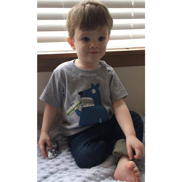 Toddler boy modeling Grubs applique t-shirt