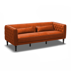 modern orange red velour tufted arm sofa with kidney pillows and turned wood leg