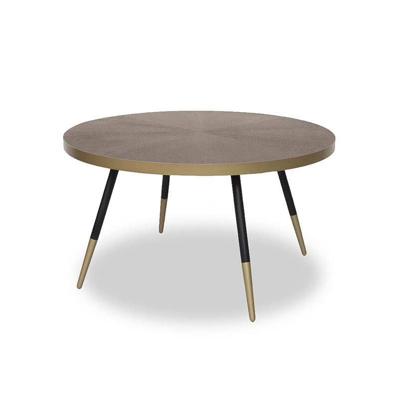 Modern round wood coffee table with black legs and gold tips