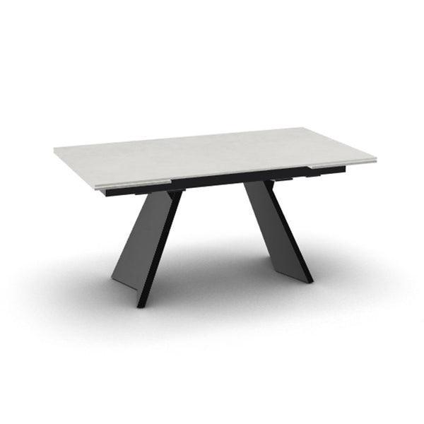 modern extendible dining table with angled legs and ceramic top made in Italy
