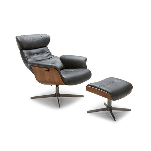 Black modern reclining leather chair and ottoman with walnut accent and black chrome steel base shown reclining