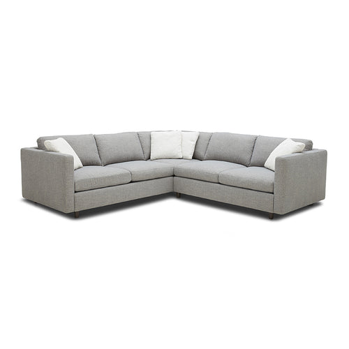modern sectional in pebble grey fabric with dark wood feet