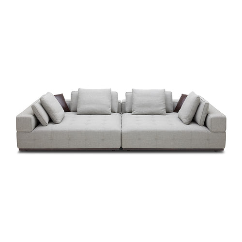 modern oversized modular button tufted sofa in light grey fabric with dark wood base