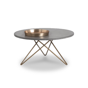 modern round concrete top coffee table with antique brass tripod base with hairpin legs