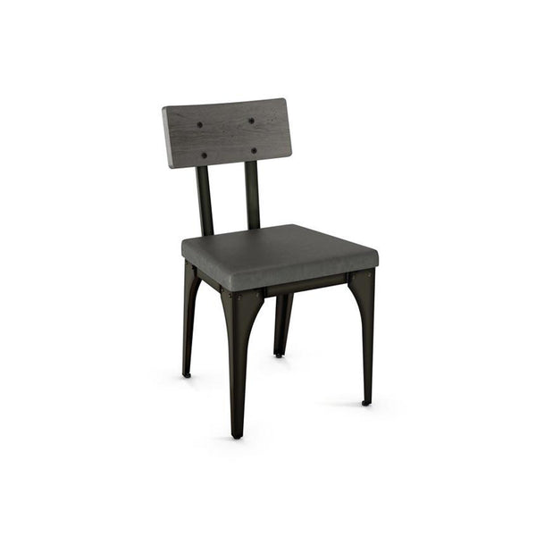 Modern industrial dining chair with upholstered seat, steel frame, and wood backrest