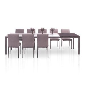 White glass and dark wood modern extendable dining table with grey powder coat metal legs and chairs