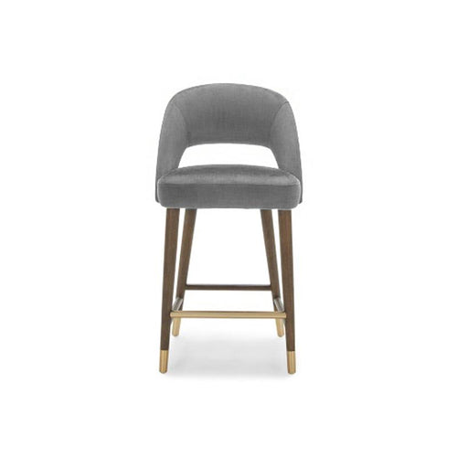 modern luxe light grey fabric counter stool with solid distressed black and gold foot caps