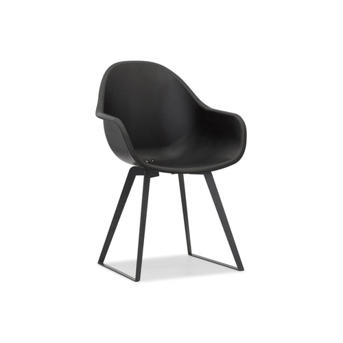 Black modern moulded plastic dining chair with black metal legs