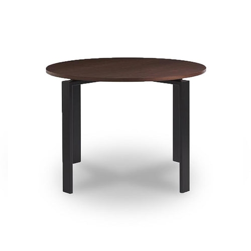 Modern round walnut topped dining table with metal base in dark bronze finish