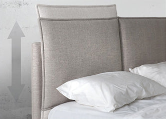 Light grey modern upholstered queen bed with brushed steel legs
