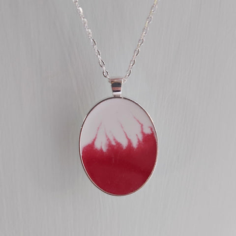 Red and white oval pendant necklace