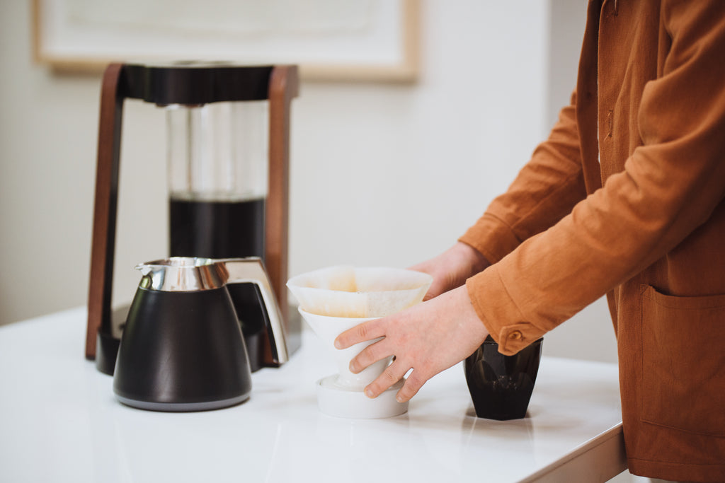 The Ratio Eight coffe machine in matte black with ceramic dripper, Chemex Paper filter, and Ratio Thermal Carafe.