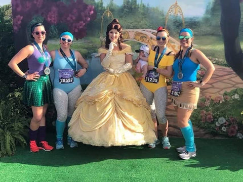 4 women at Disney Race in costumes and Ponya Bands