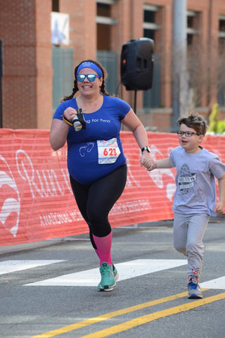 Jill Adelson racing with son in Bamboo-Lined Sweatband