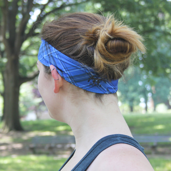 Super absorbent bamboo sweatband with a blue background and a black and white plaid stripe pattern. In a traditional sweatband style that fits well on both men and women.