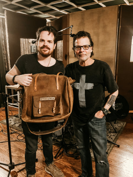 Joey presenting sterloid with his TAMBOUR BAG