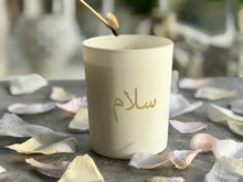 Load image into Gallery viewer, Arabic scented candle in white glass etched pot with salaam peace in Arabic writing