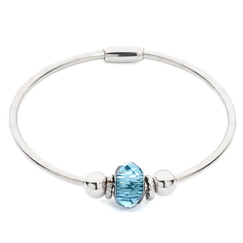 Related product : Bracciale rigido rodiato con passante centrale Swarovski blu denim