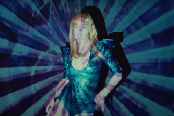 Mark Stoermer blood and guts music video turquoise bodysuit by Lena Quist