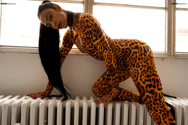 Dance fashion editorial with model in leopard print bodysuit and leggings