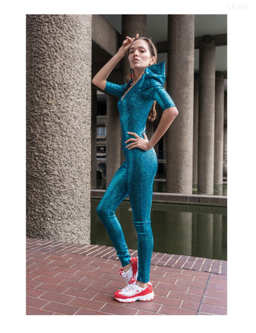 turquoise glitter catsuit stage costume with red white sneakers