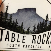 "Load image into Gallery viewer, Linville Gorge Wilderness Sticker  Table Rock 3.4""  by Kat Ryalls watercolor North Carolina blue ridge mountains journey travel"
