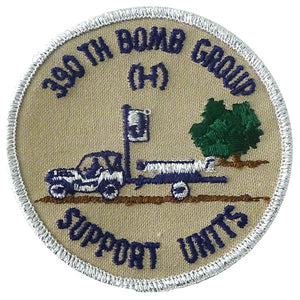 jacket patch a picture of a jeep towing a bomb, text around 390th bomb group (H) support units