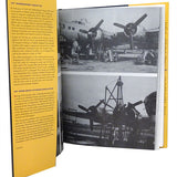 interior pages of large book with black and white photos