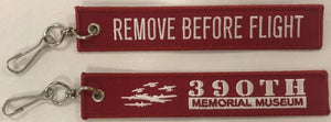 """Remove before Flight"" key chain, with B-17's and 390th logo"