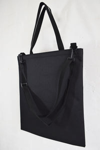 Goodstart Jones black shopper bag and tote bag with shoulder strap .