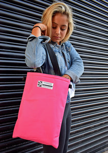 pink tote bag worn by girl Goodstart Jones