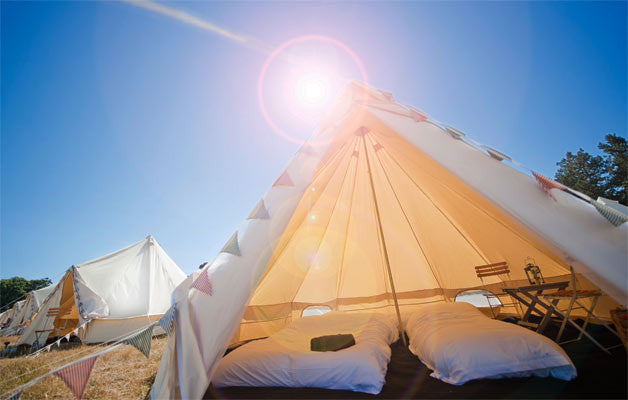 Port Eliot Classic Bell Tent. White cotton linen with high quality duvet and pillows.
