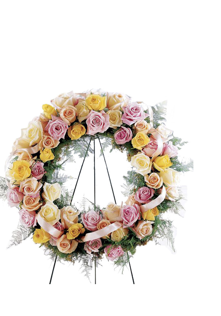 funeral flowers pastel rose open heart wreath
