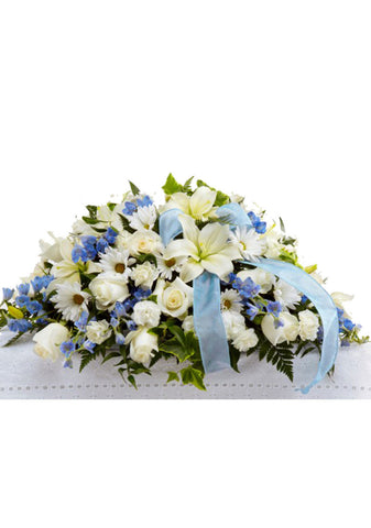 funeral flowers casket spray blue and white