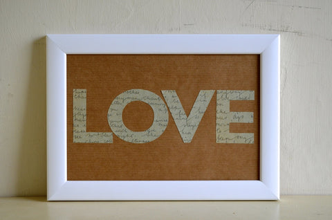 Love cut from vintage letters ephemera