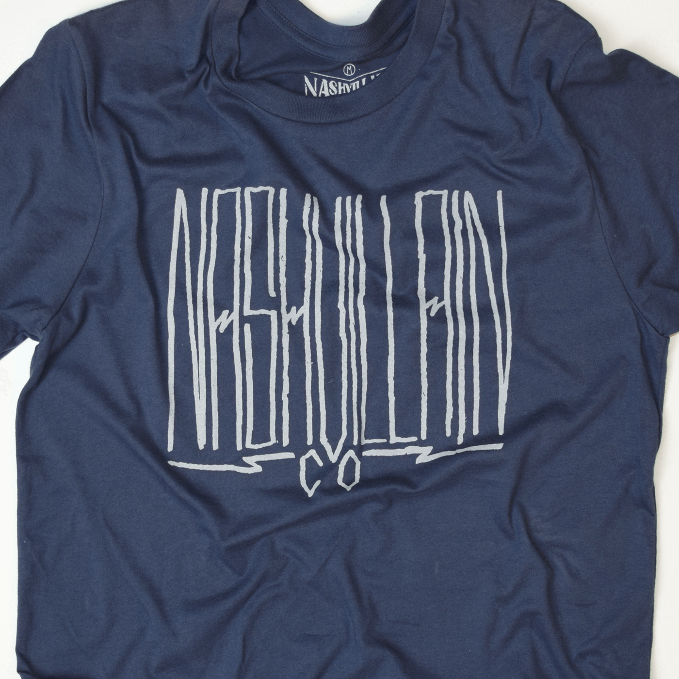 Tall boy hand written nashvillain type graphic design shirt