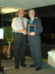 Gary Adkins receives 25 years Outstanding Service Award from PNG Executive Director Robert Brueggman