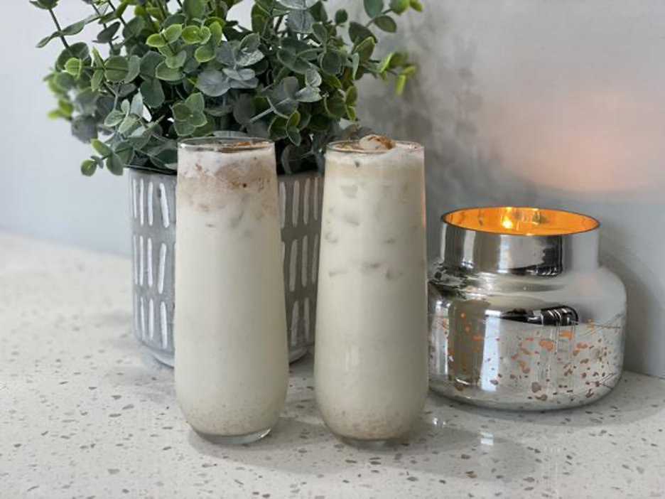 Brandy Alexander Drinks with Plant and Candle Background
