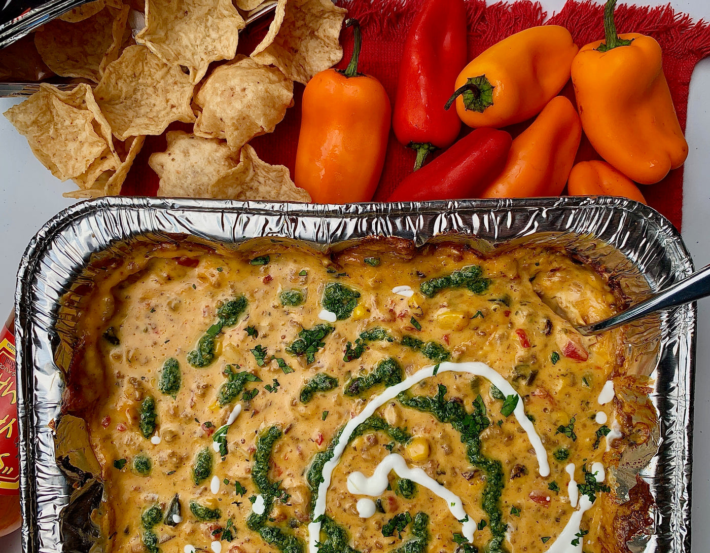Pan of Roasted Queso Dip with Peppers and Nachos
