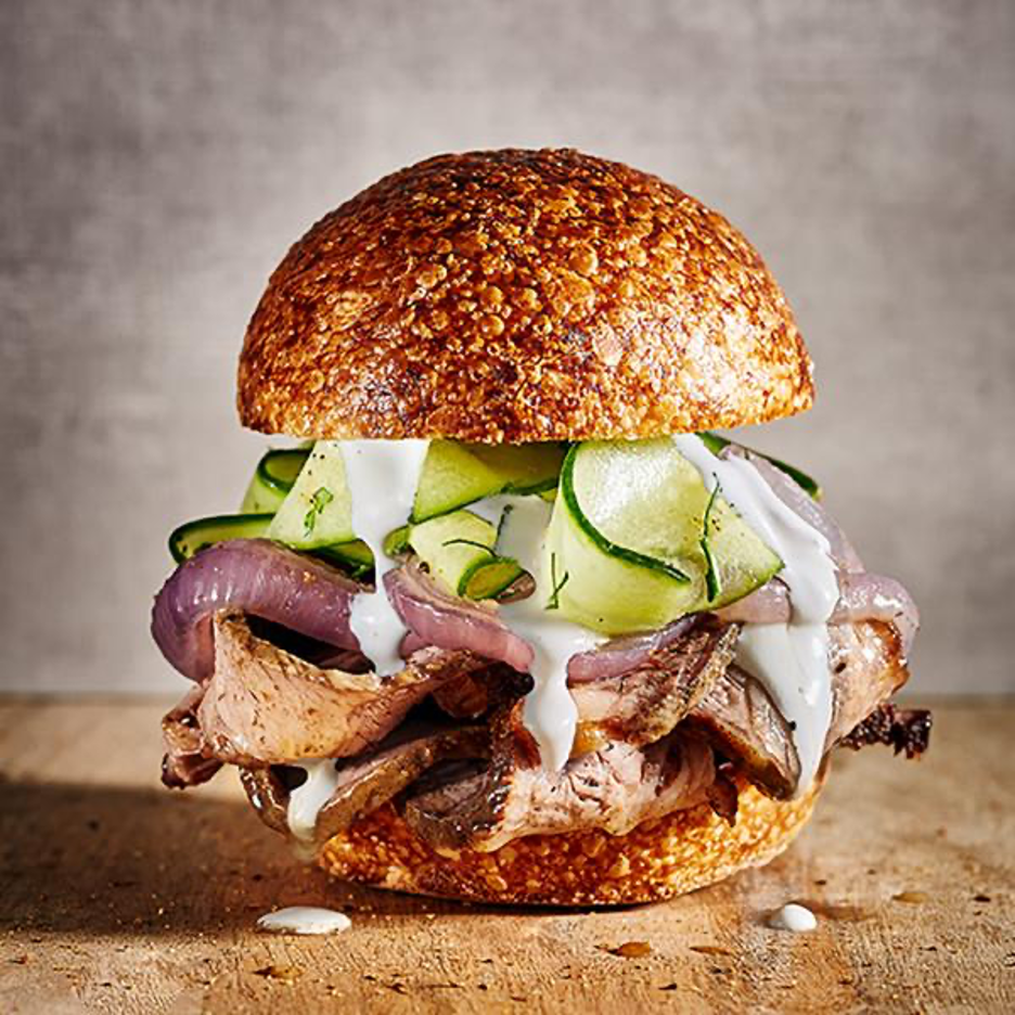 Pit Barrel Smoked Brisket Sandwich with Onion, Cucumber, and Horseradish