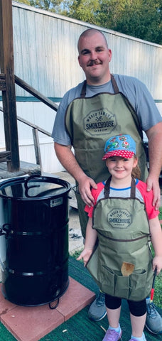 justin and daughter with pit barrel cooker