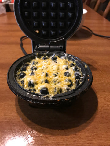 melted cheese on mini waffle iron for chaffle