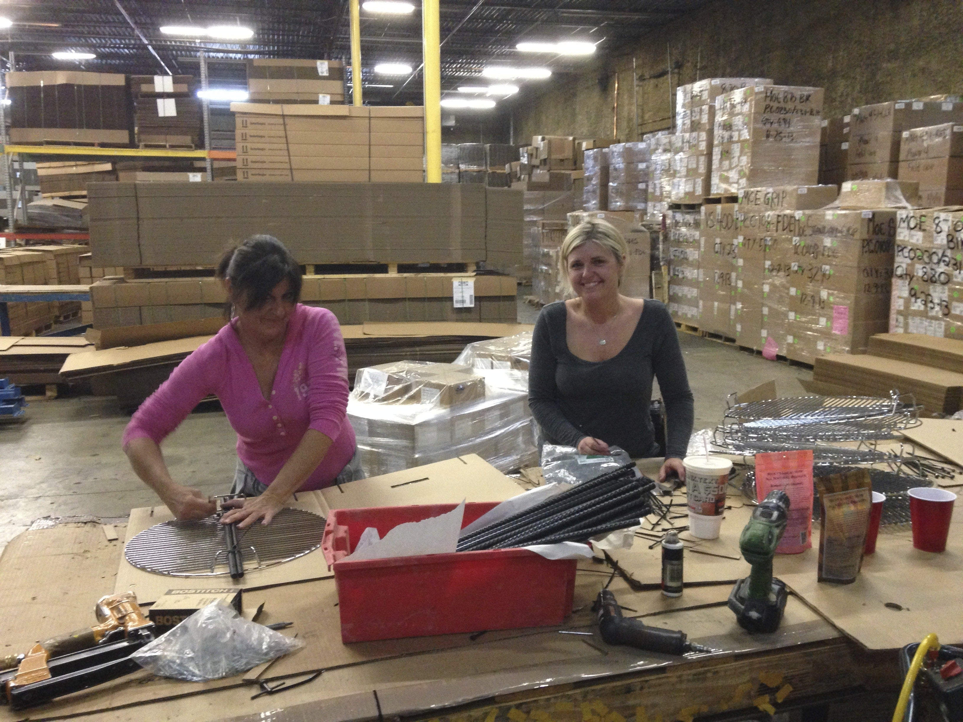 (Keeping mom busy) – Amber and her mom packing out Pit Barrel® Cookers.
