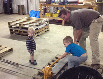 Noah getting a little bit of help from his boys.